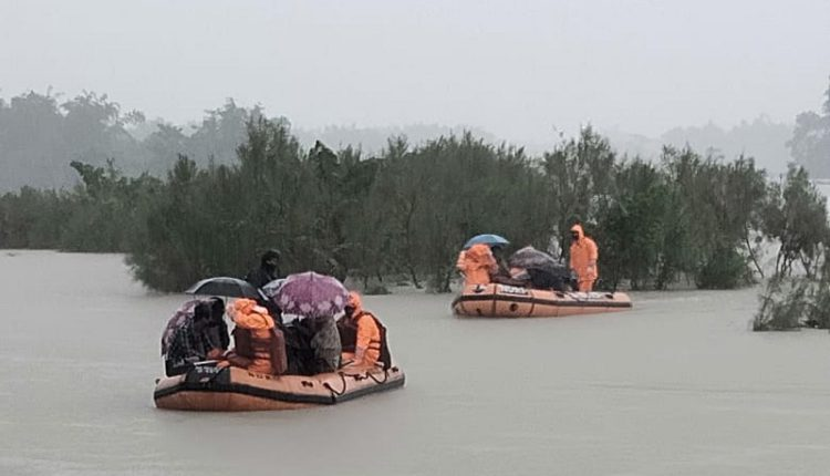 Barpeta: NDRF personal rescue flood affected villagers at Hallang Bari under Bajali revenue Circle in Barpeta district of Assam on July 11, 2020. (Photo: IANS)