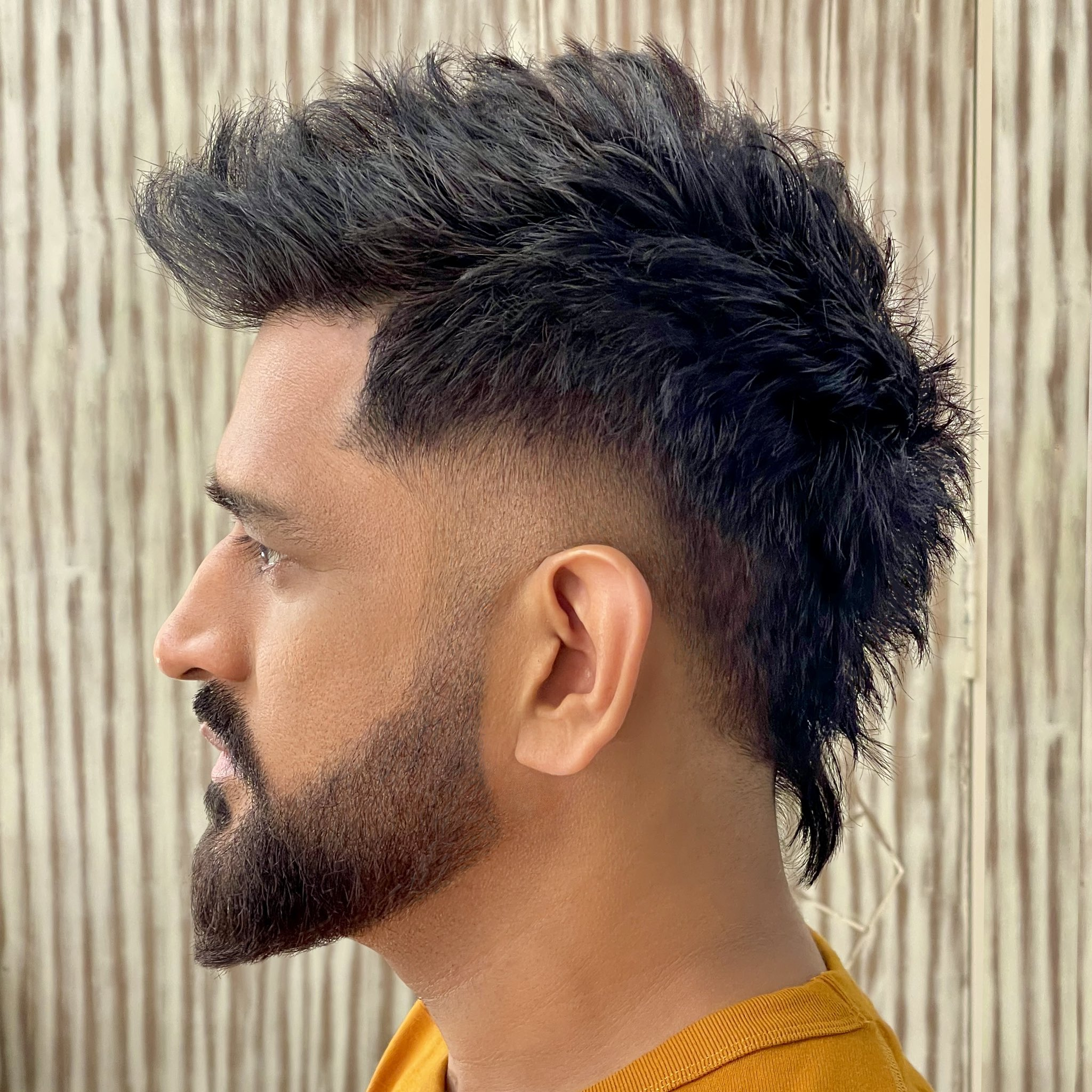 Dhoni's new hairstyle surprise fans